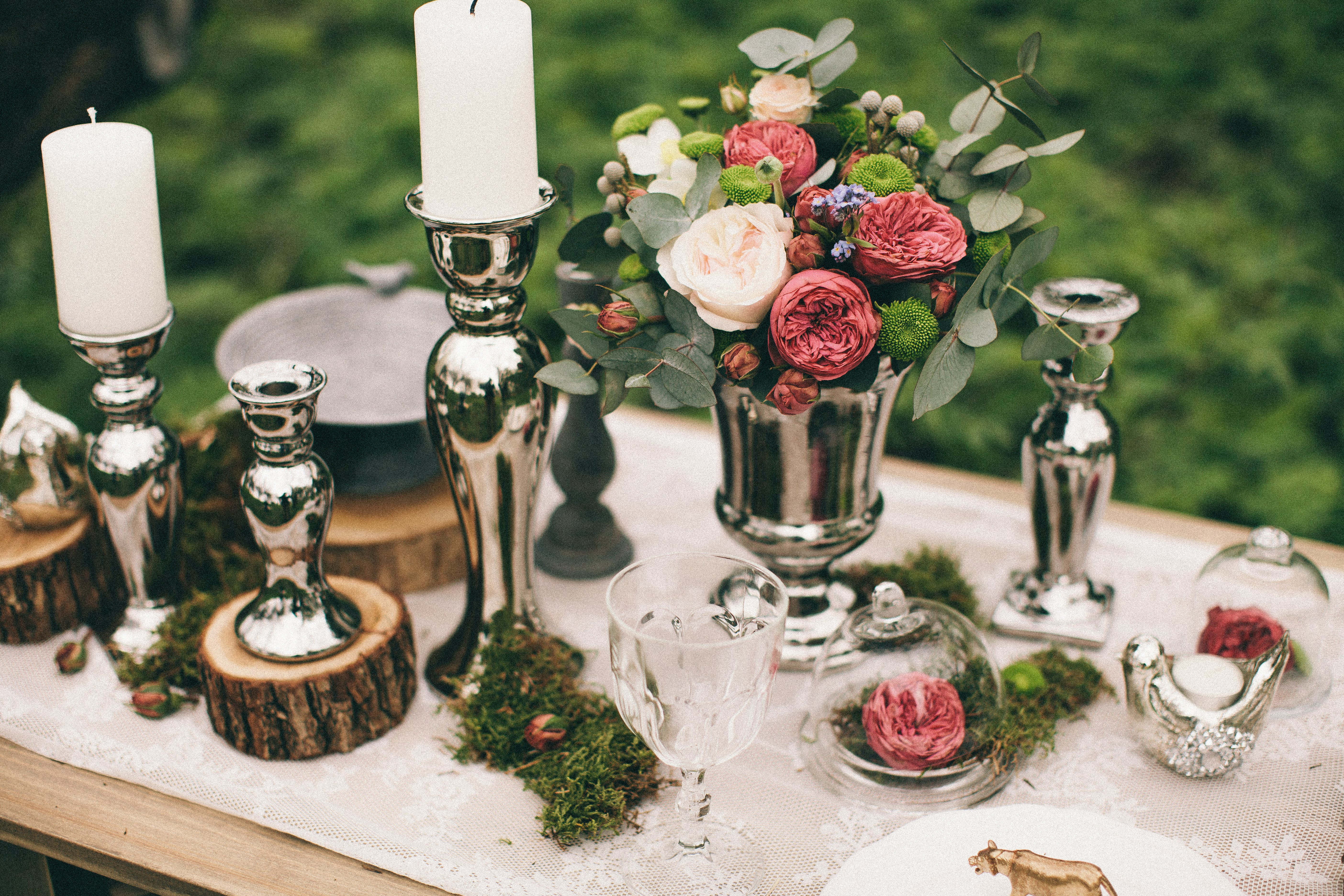 Silver Candle Holders On A Table