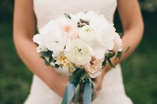 Close-Up Photo of Person Holding Bouquet