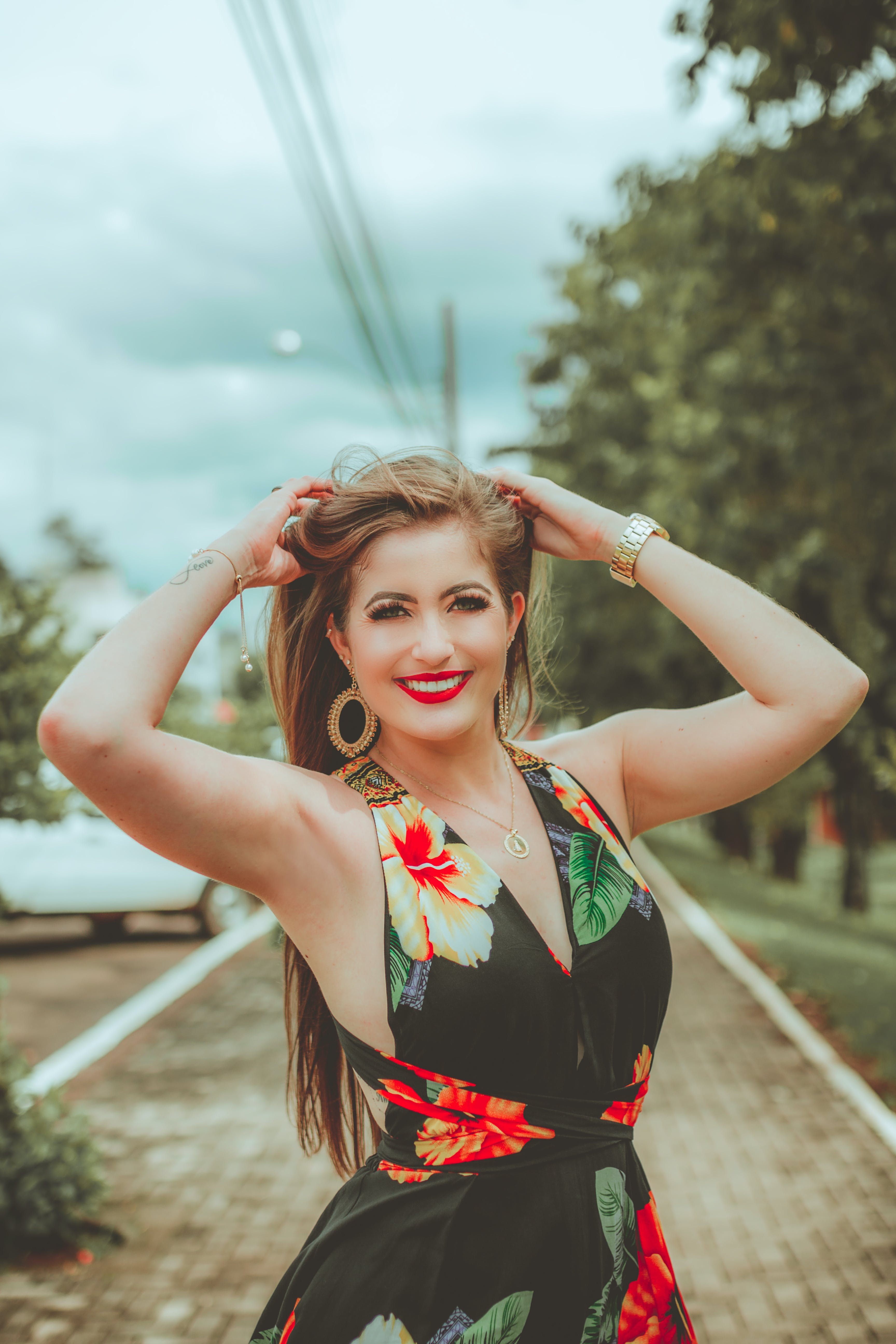 Photo of Smiling Woman in Black Floral Dress Smiling