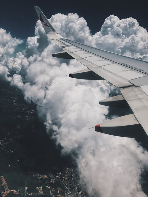 Aircraft Wing Over Clouds