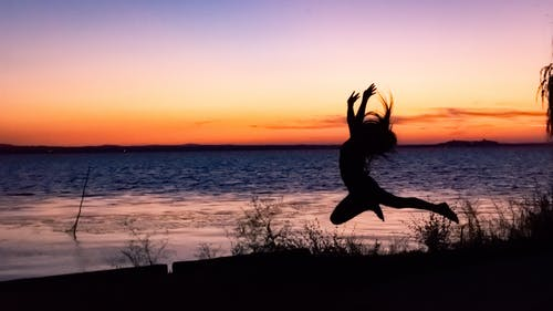 Free stock photo of girl, jump, sunset