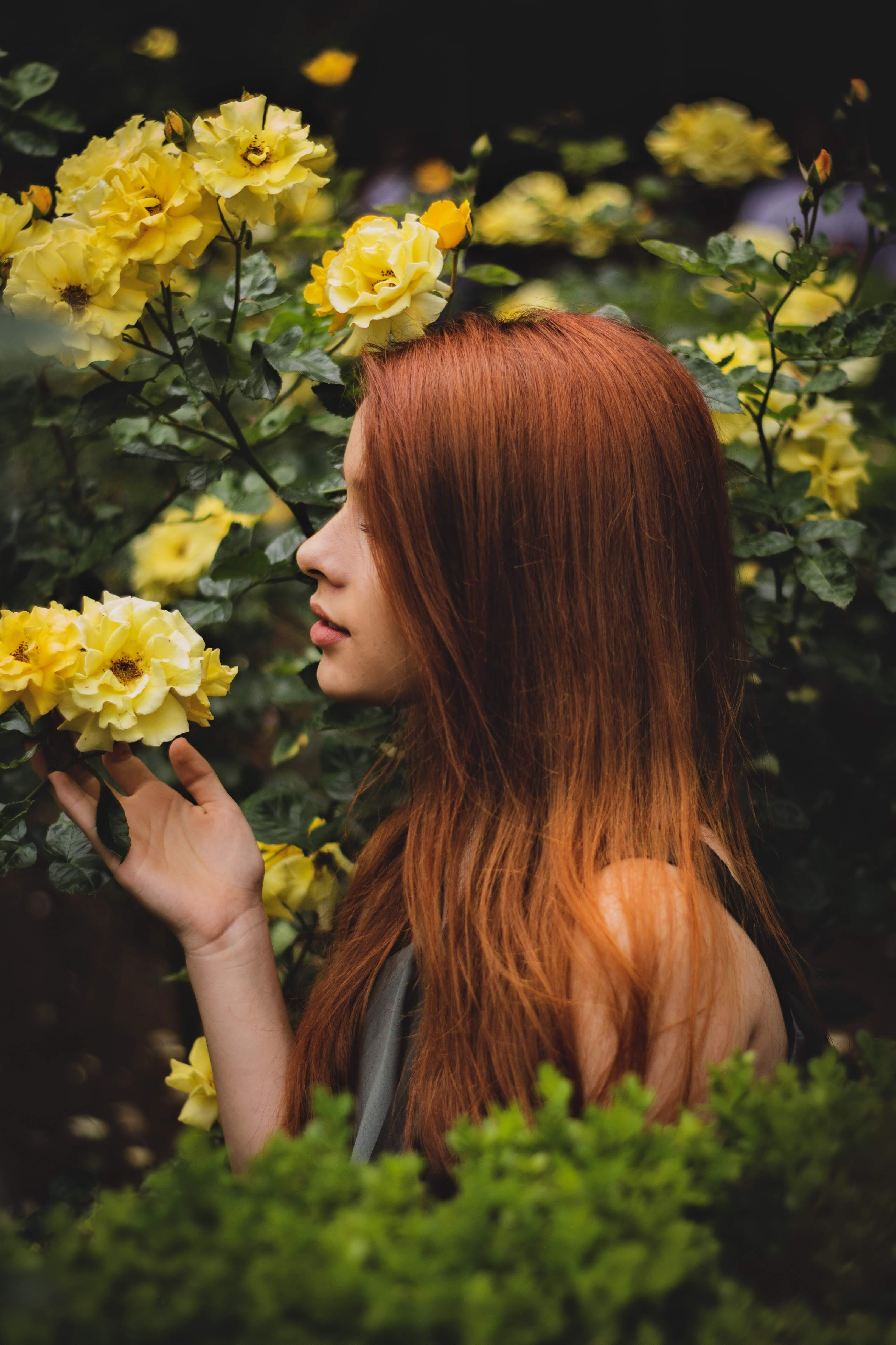 Photo of Woman Holding Flower