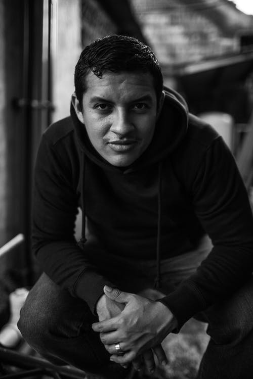 Black-and-White Photography of a Man in Hooded Sweatshirt