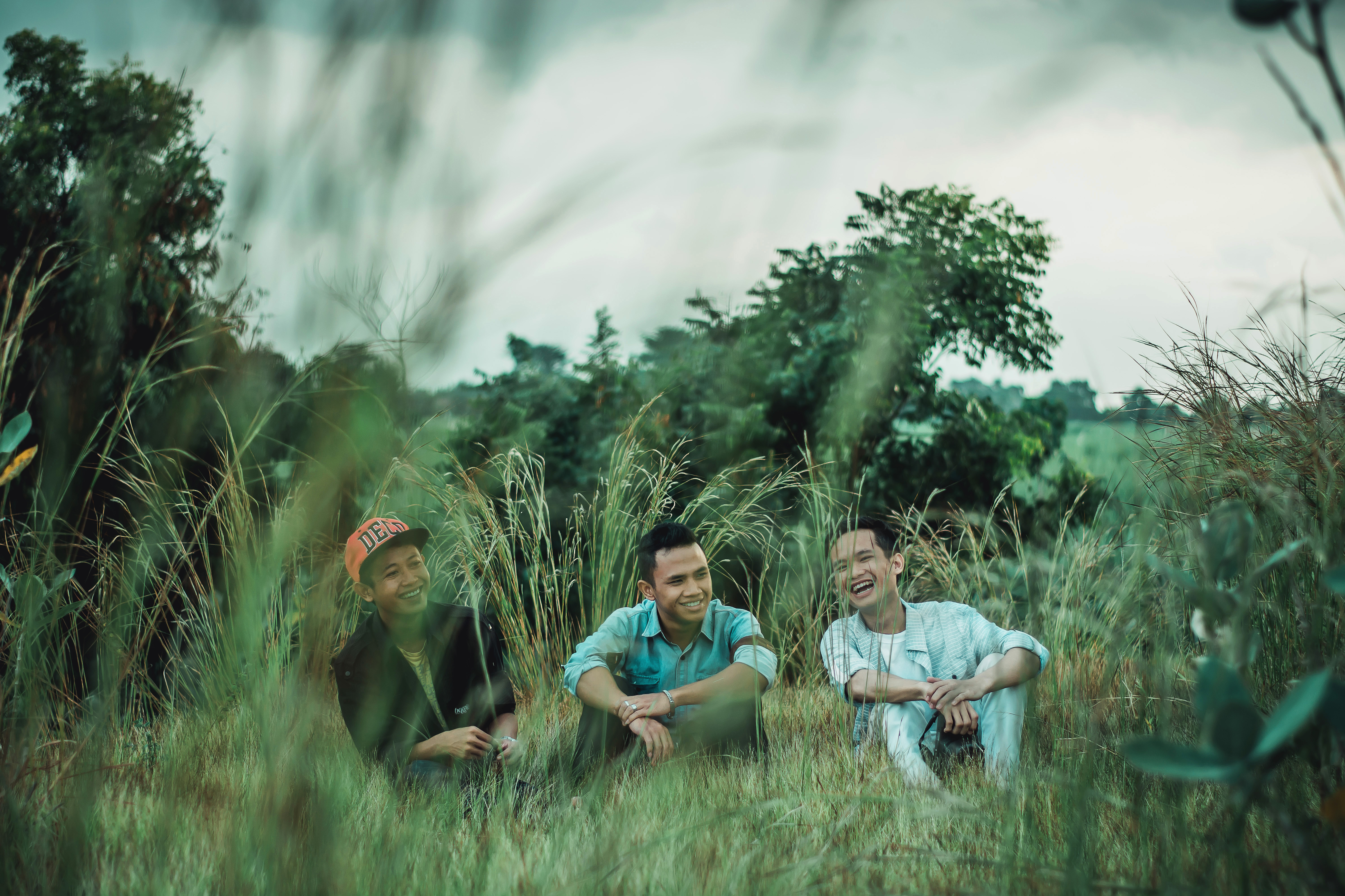 Photo of Men Sitting on Grass