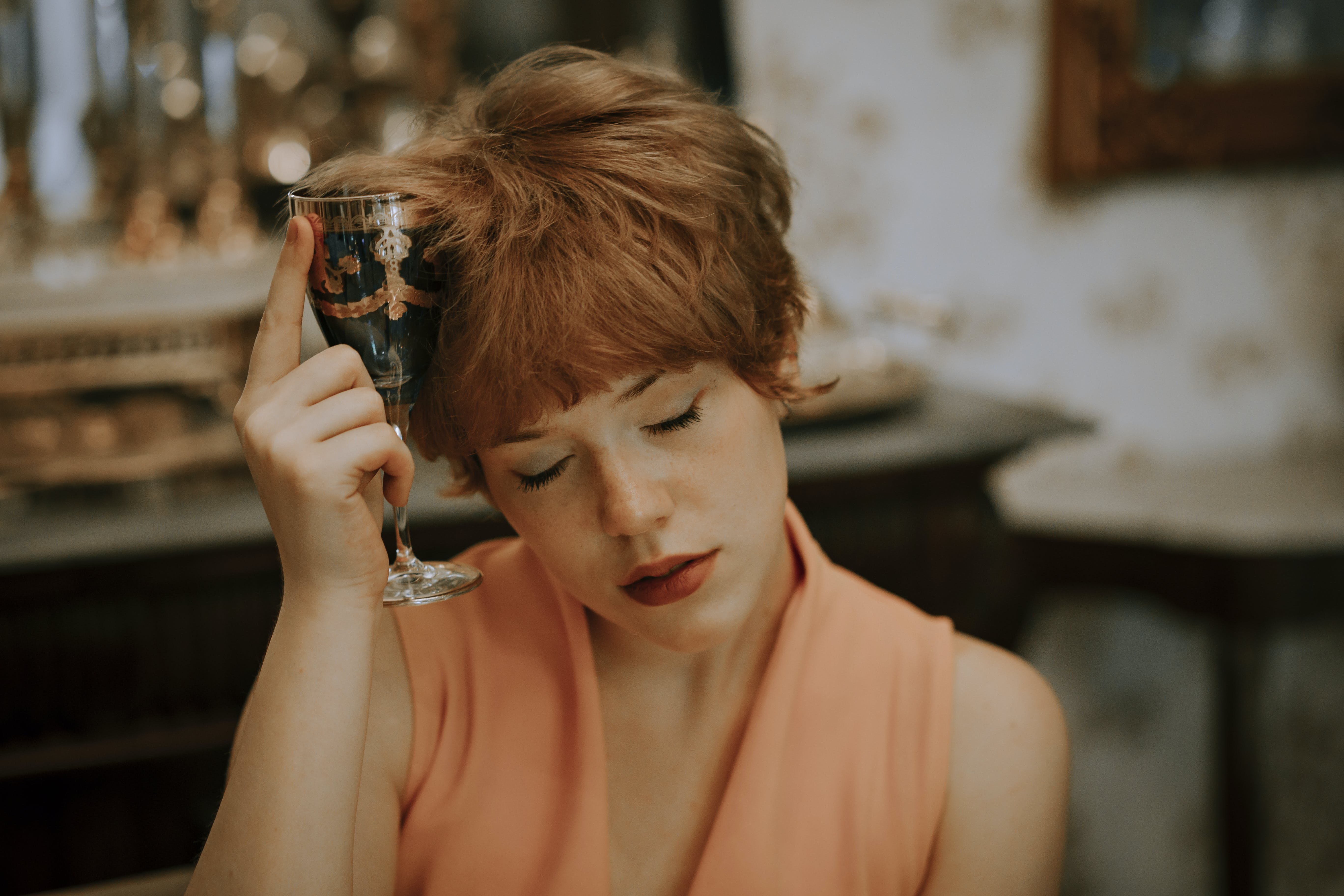Photo of Woman Holding Champagne Glass