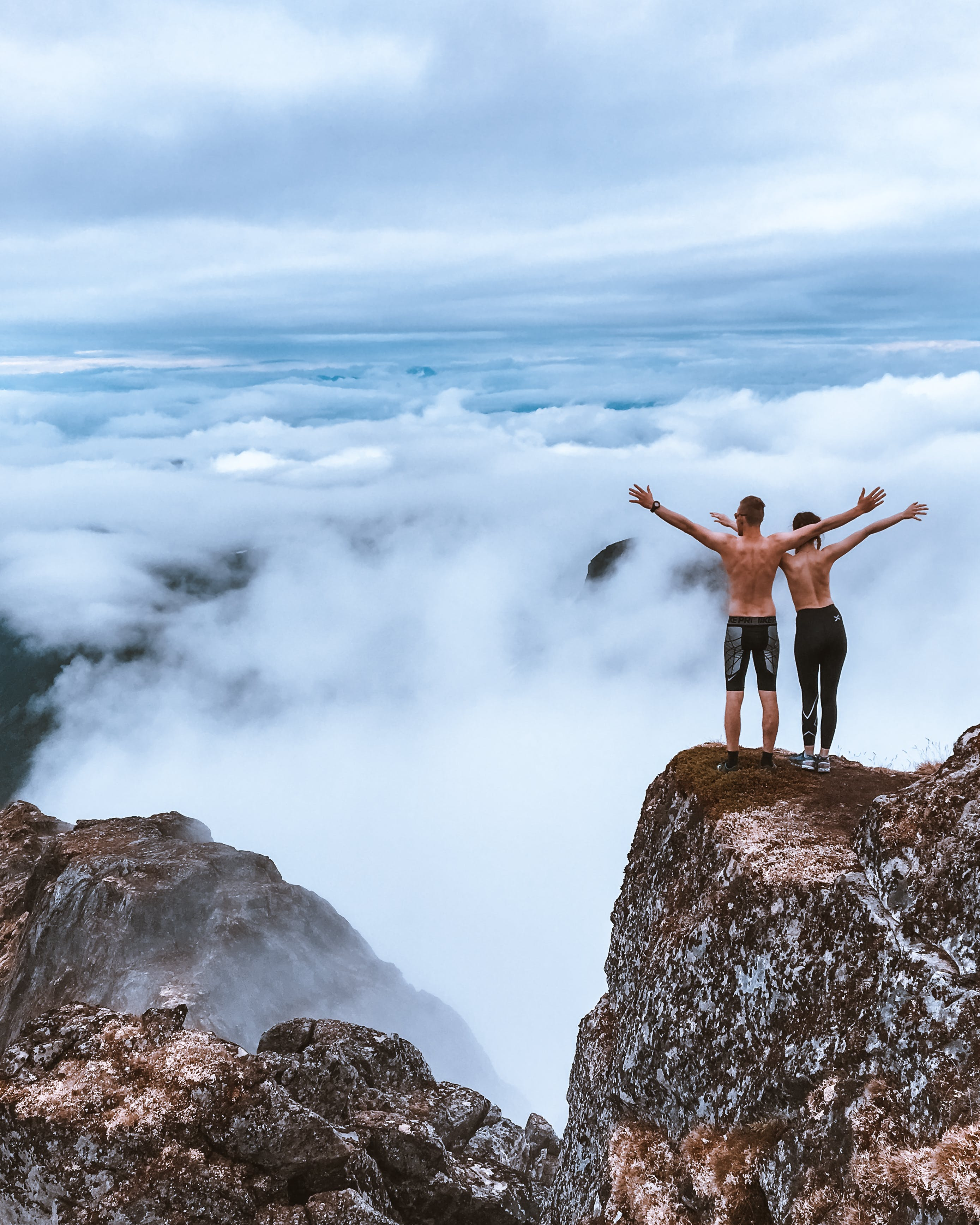 Scenic Photo of People Standing on Cliff