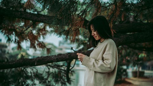 Photo of Woman Wearing Sweater