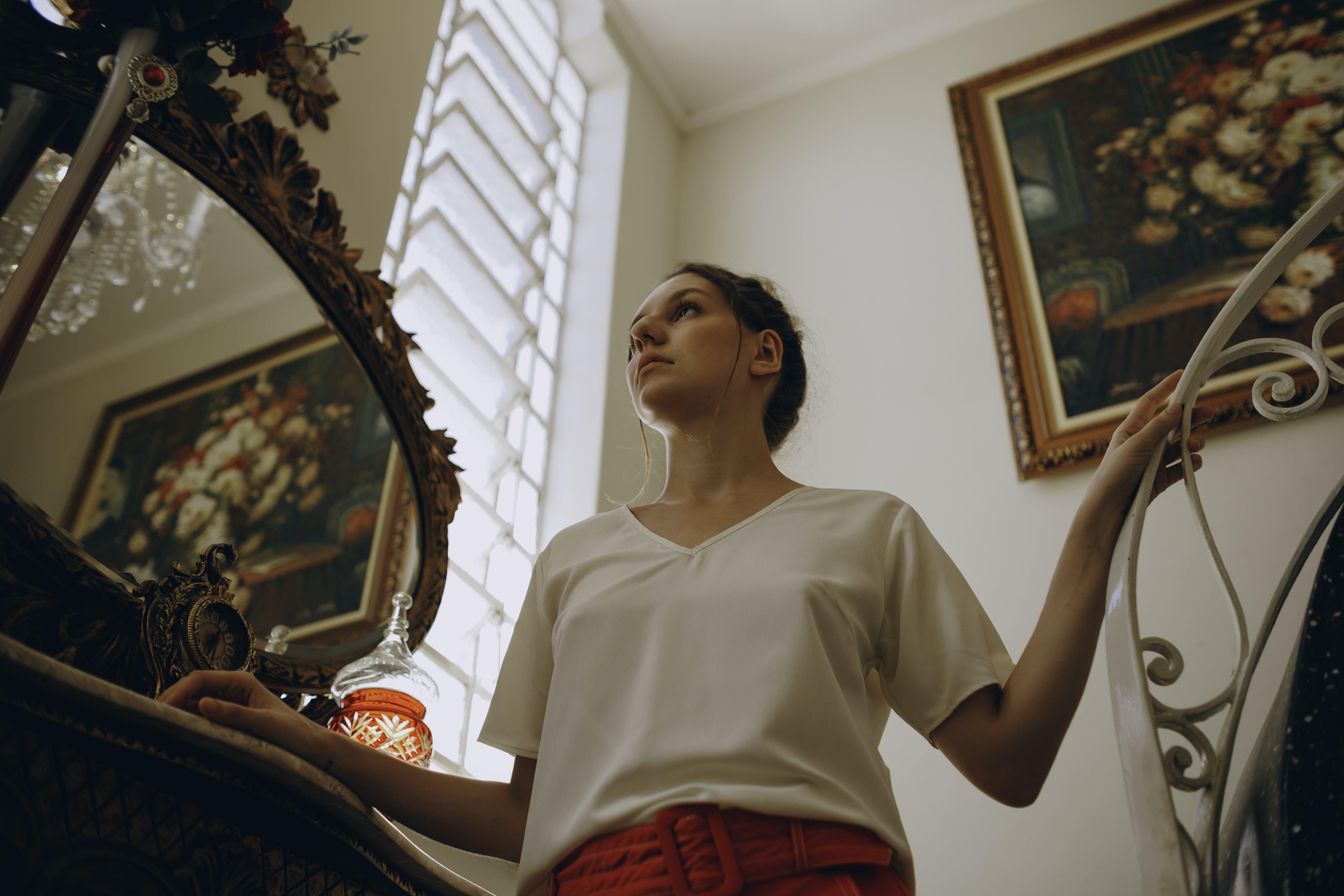Photo of Woman Wearing Blouse