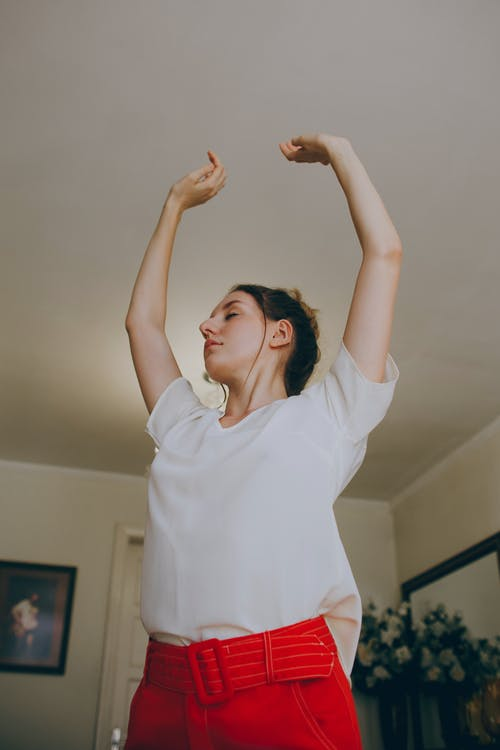 Photo of Woman Raising Her Both Hands