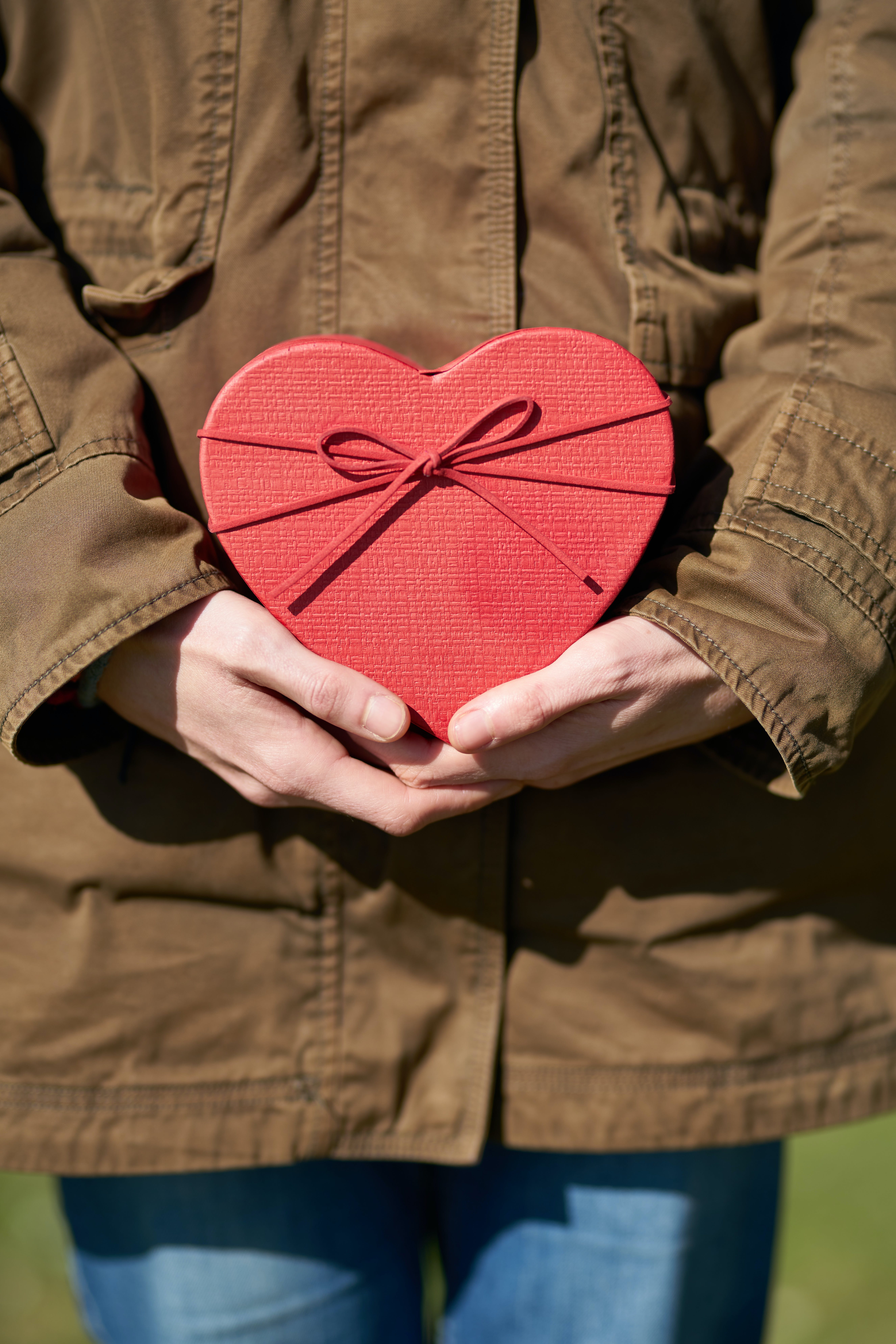 Person Holding Heart Shaped Gift