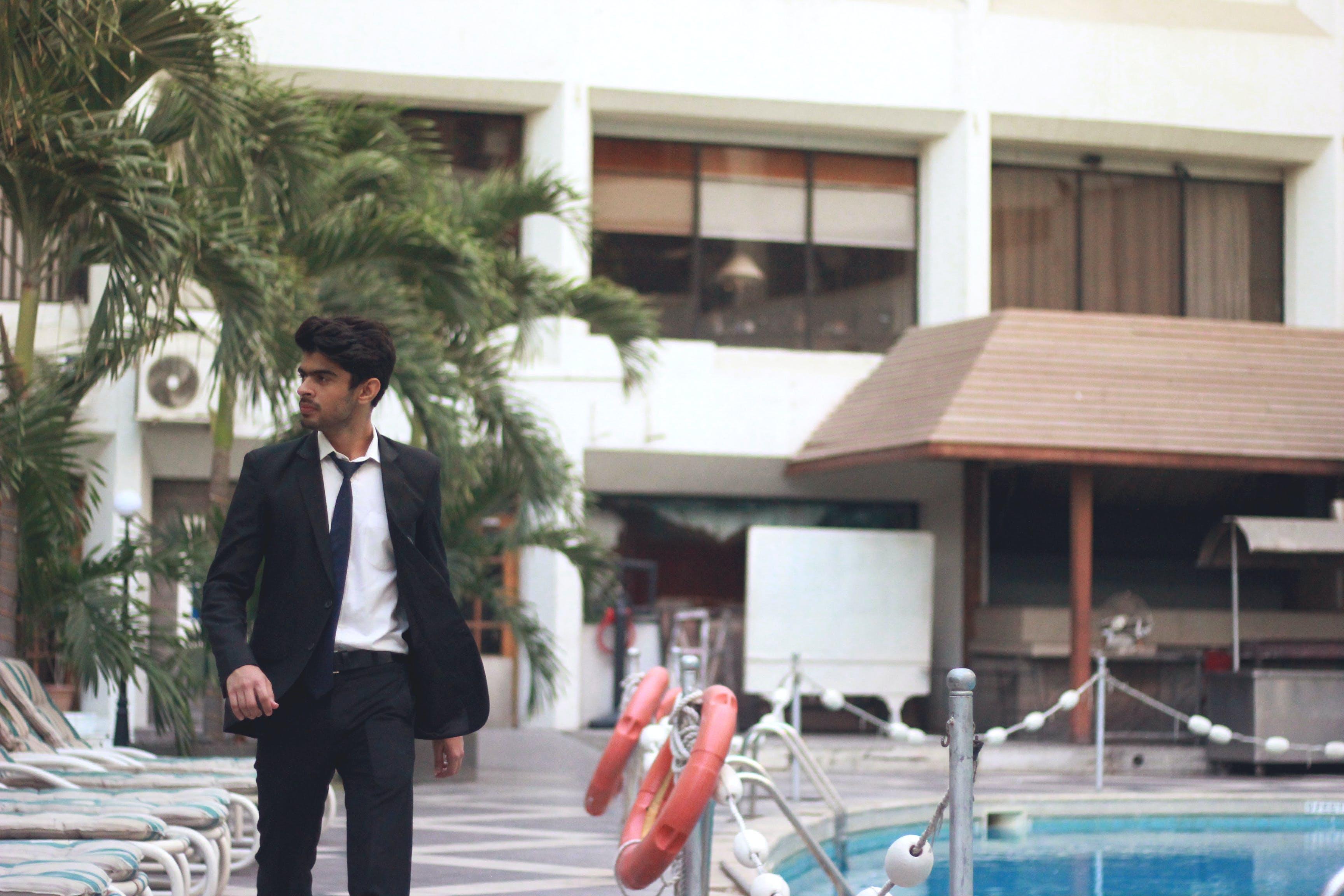 Free stock photo of black coat, hotel, men, mensuit