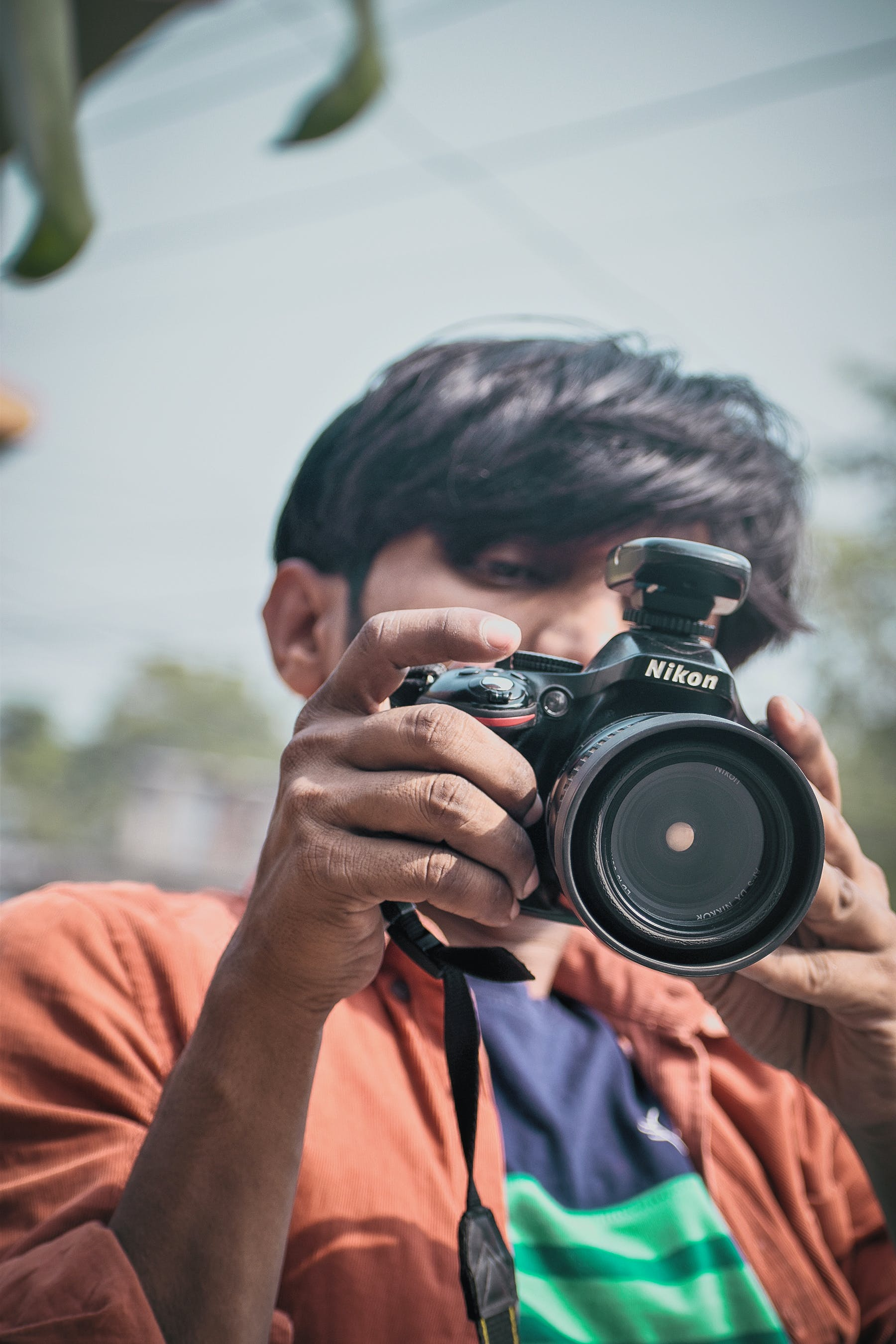 Free stock photo of adult, blur, camera, dslr camera