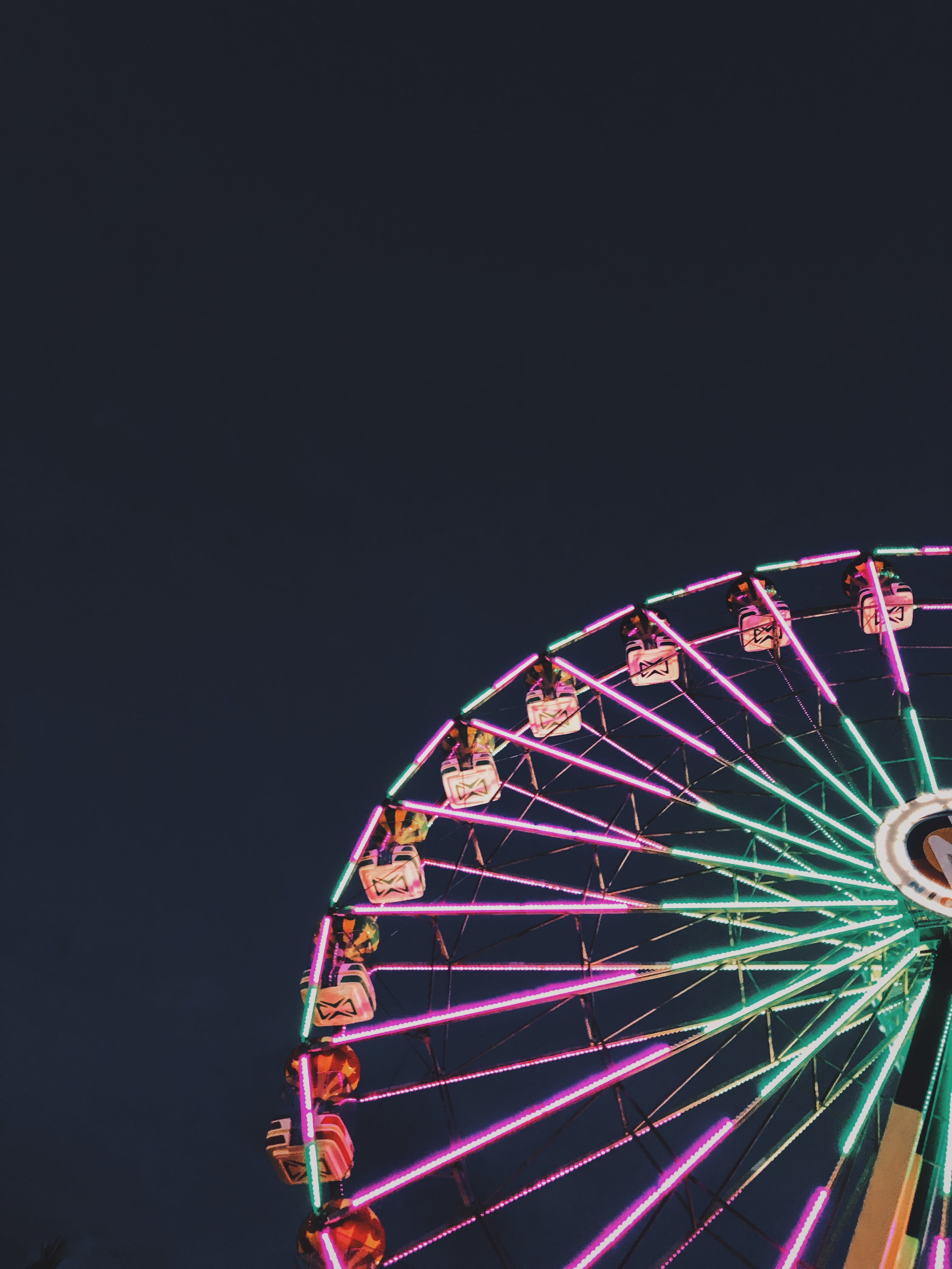 Photo of Ferris Wheel with Neon Lights at Night