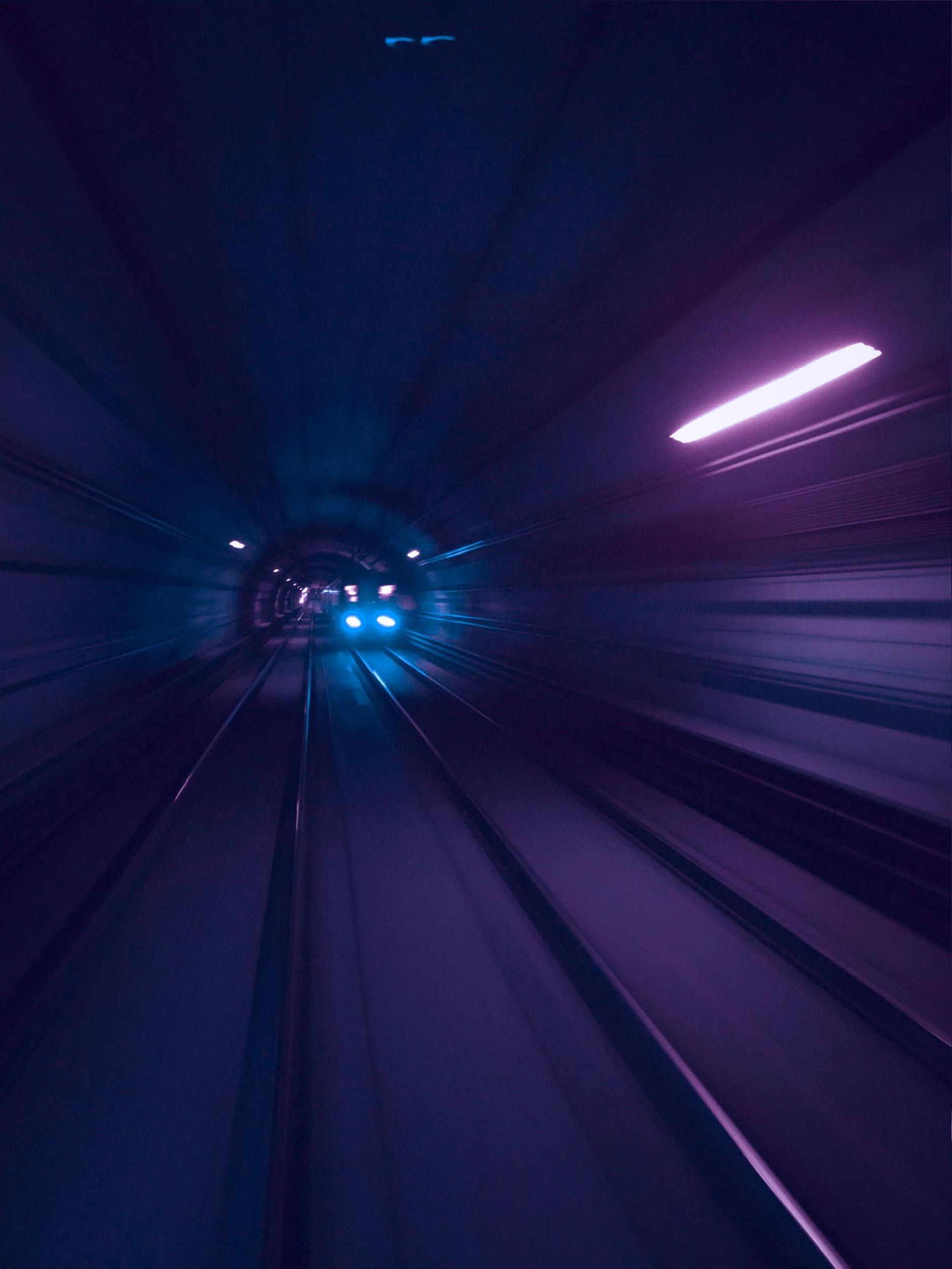 Purple Light Photo of Tunnel