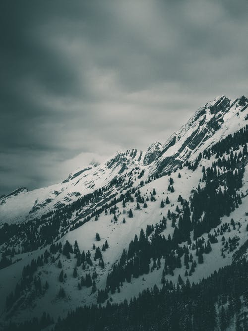 Snow Covered Mountain Under White Cloudy Sky