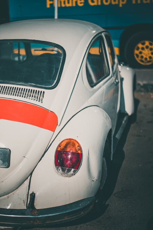 Classic White volkswagen beetle Coupe Parked Near Vehicle