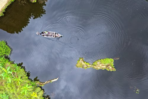 Aerial View Of Boat In The Middle Of Body Of Water