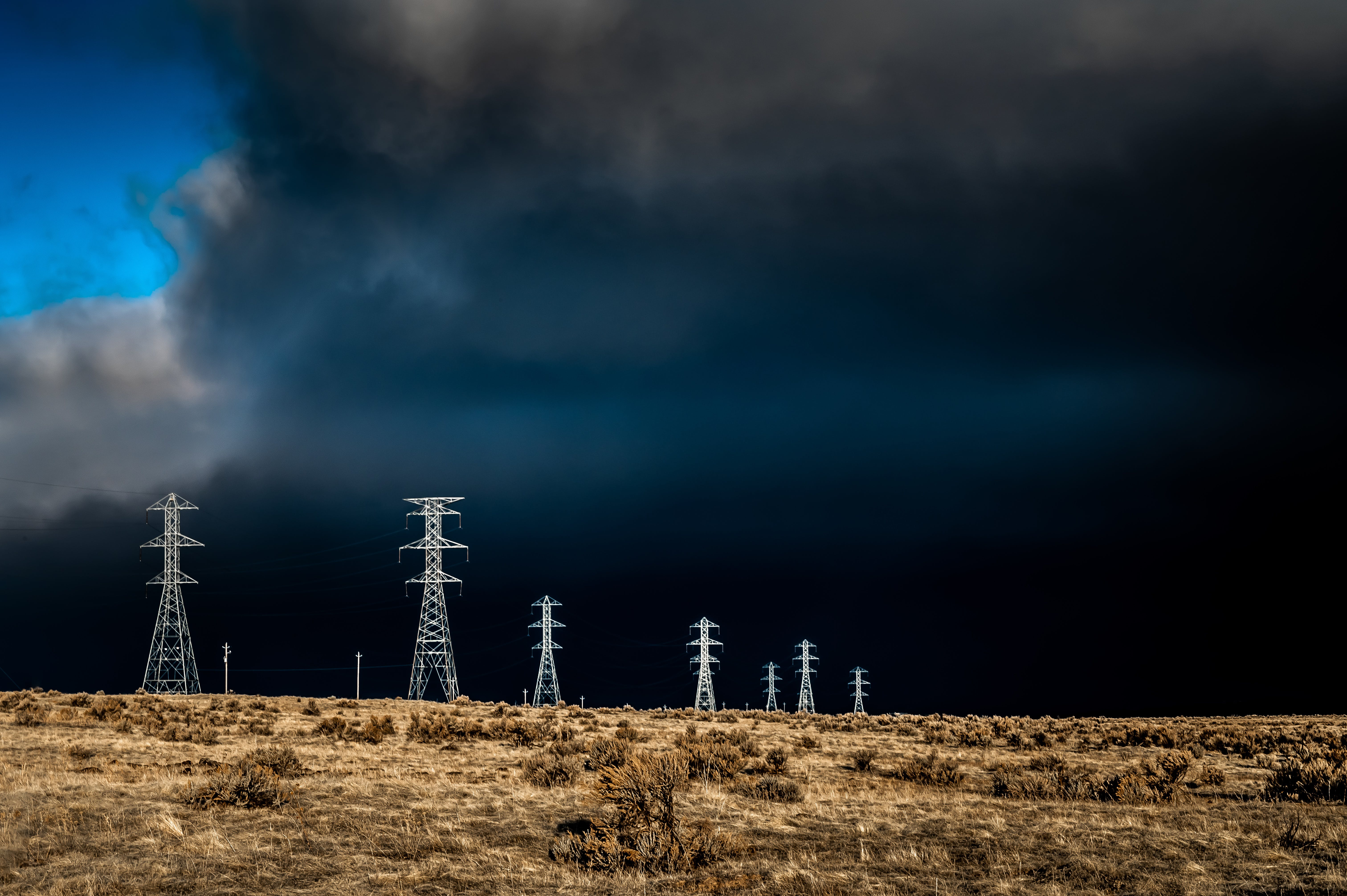 Electric Lines Over Cloudy Sky