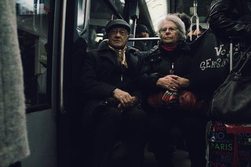 Elderly man and woman in subway train