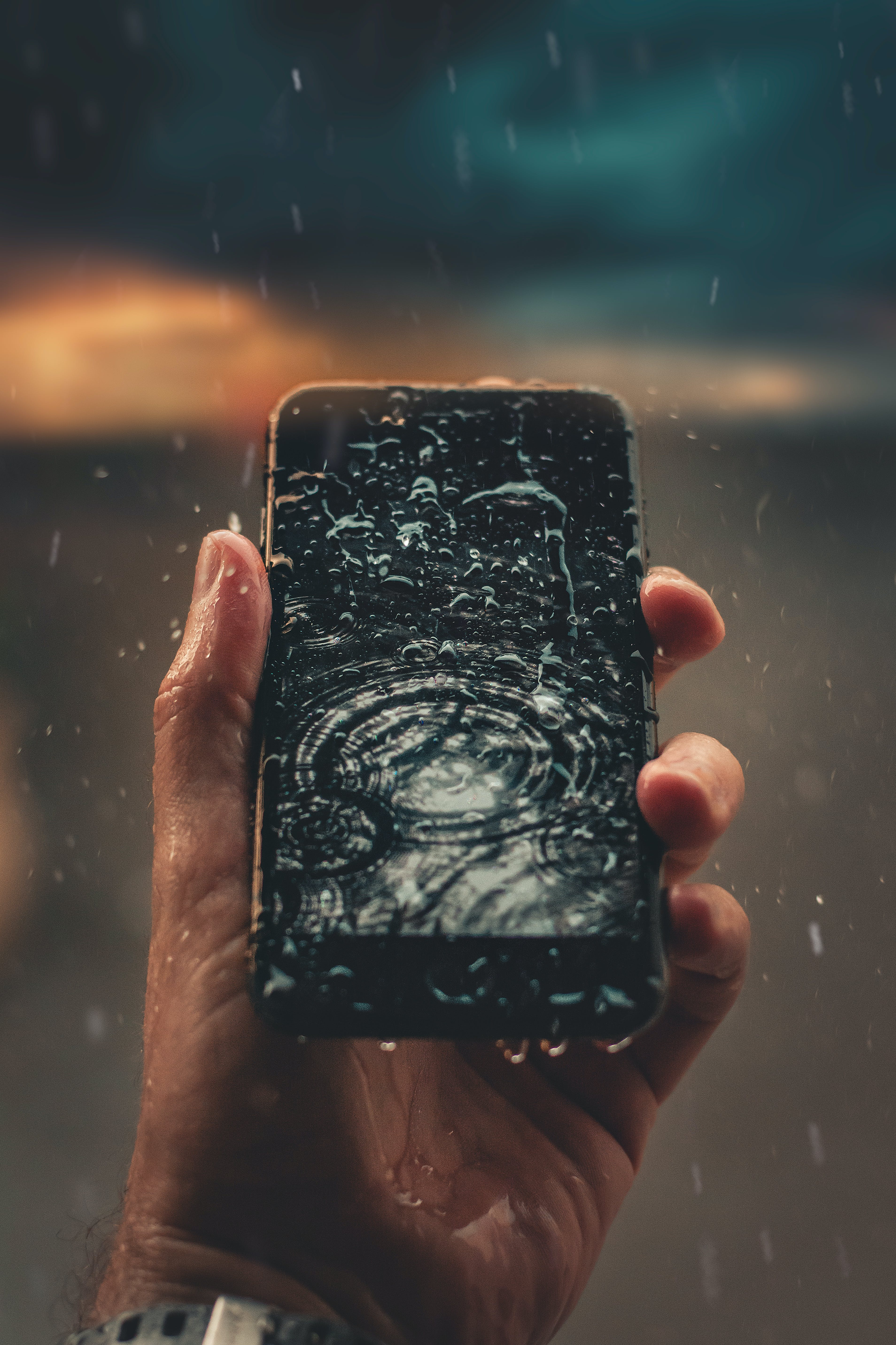 Photo of Person Holding Wet Smartphone