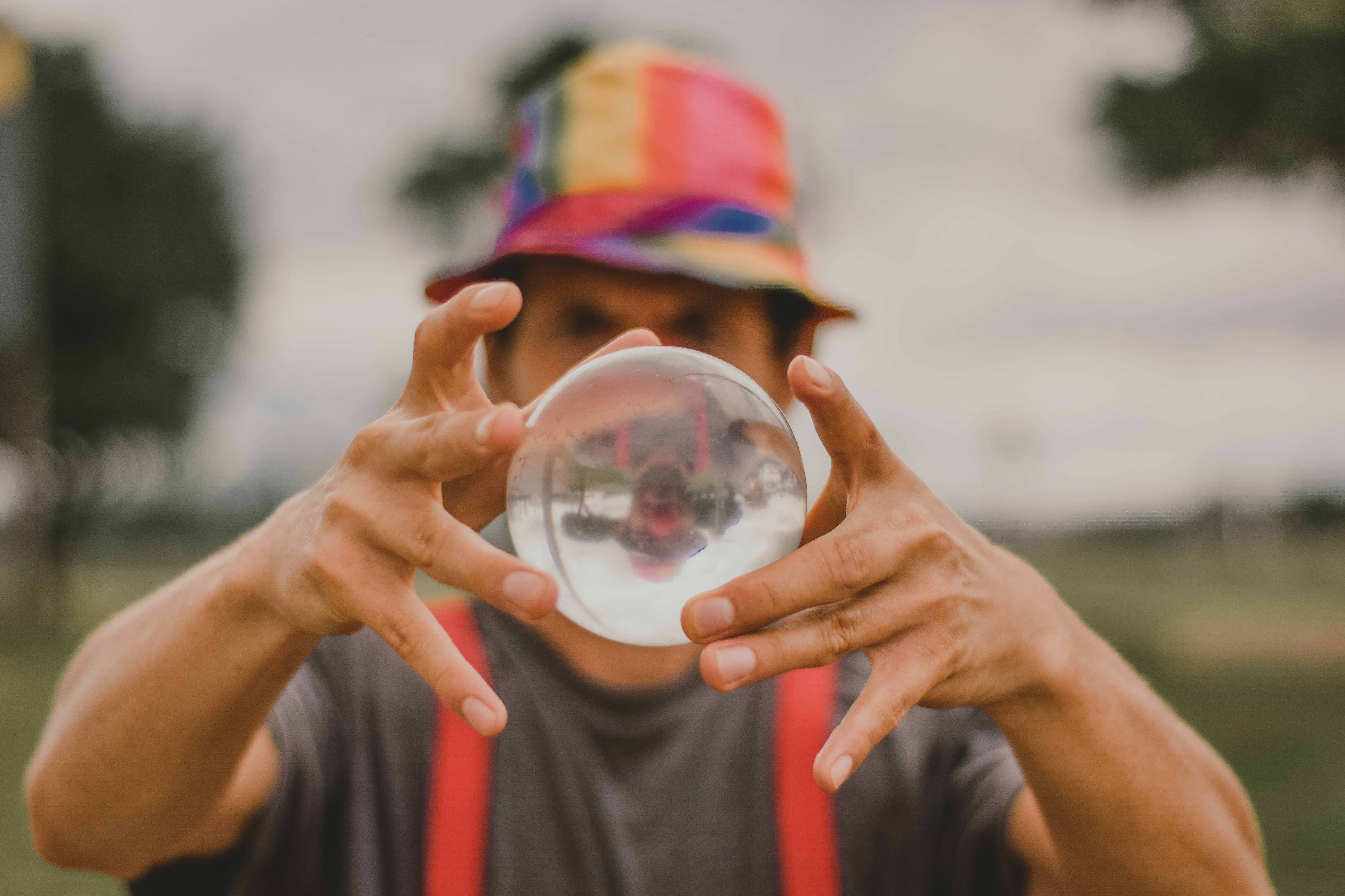 Close-Up Photo of Man Holding Lensball