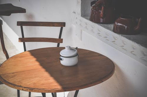Round Brown Wooden Table and Chair