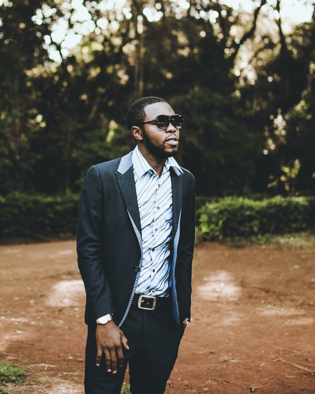 Photo of Man Wearing Suit