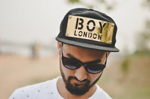 Photo of Man Wearing Cap and Sunglasses