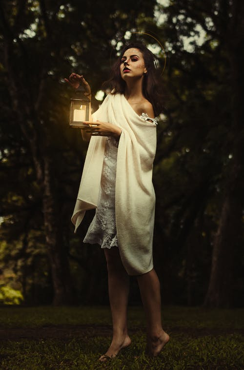 Woman Holding Candle Lantern