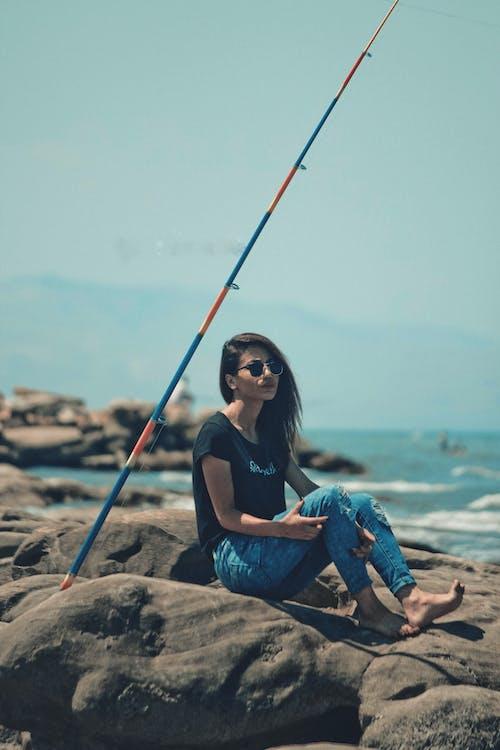 Free stock photo of beach, girl, girl in sea, rock