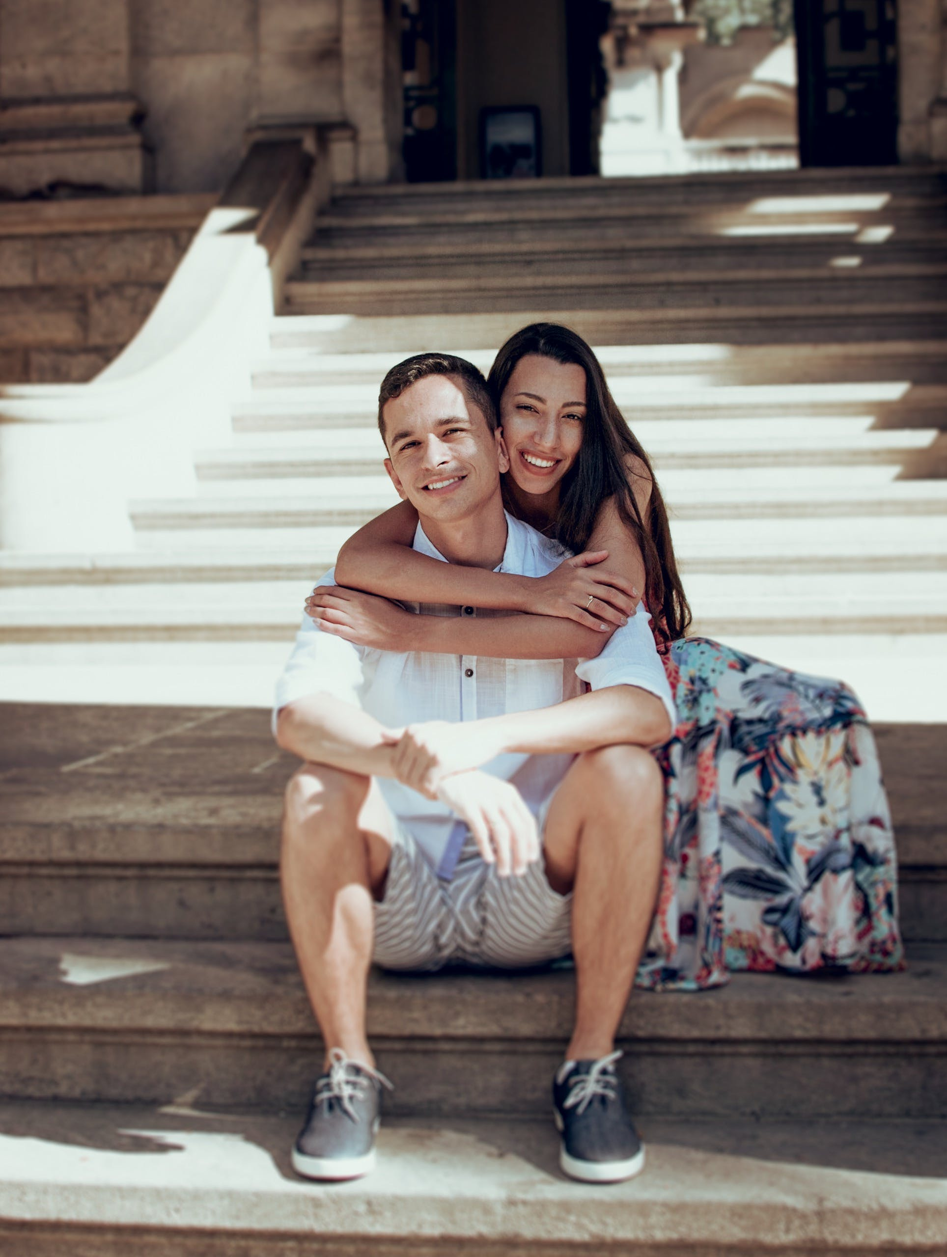 Woman Hugging Man on Stairs