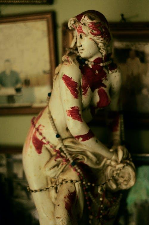 White Red and Black Ceramic Figurine