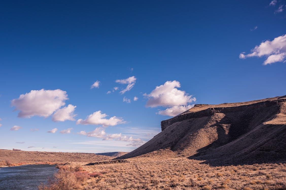 Sand Dunes Near Body of Water