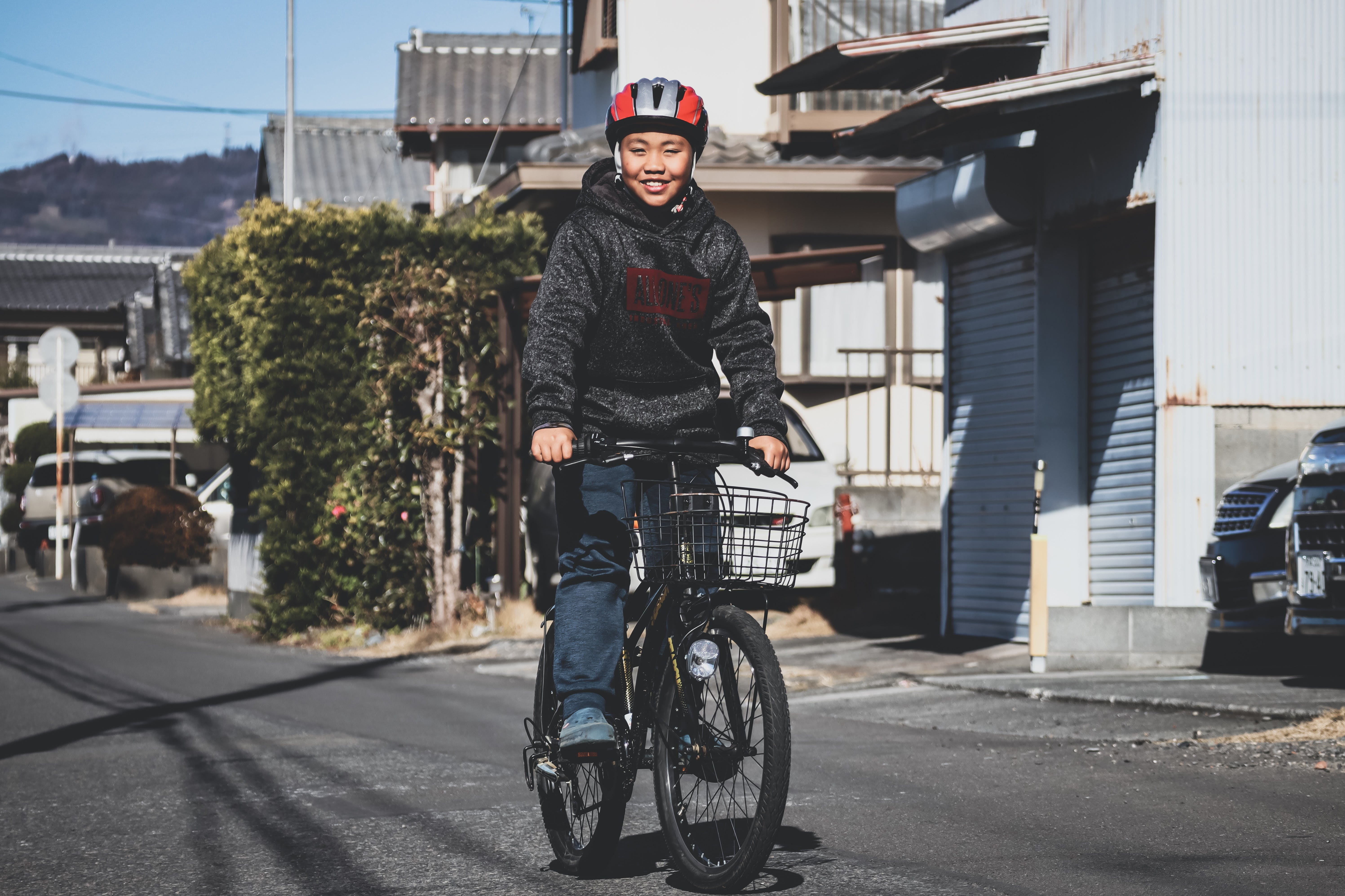 Photo of Woman Riding on Bicycle on Street