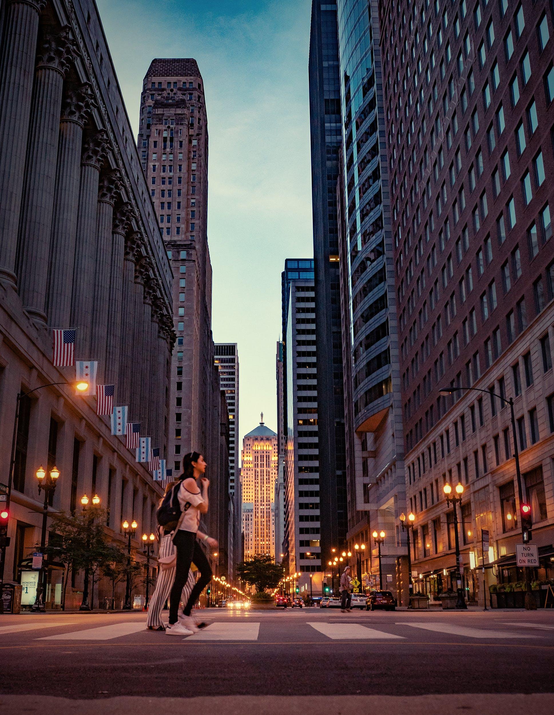 Two Women Crossing Pedestrian Lane