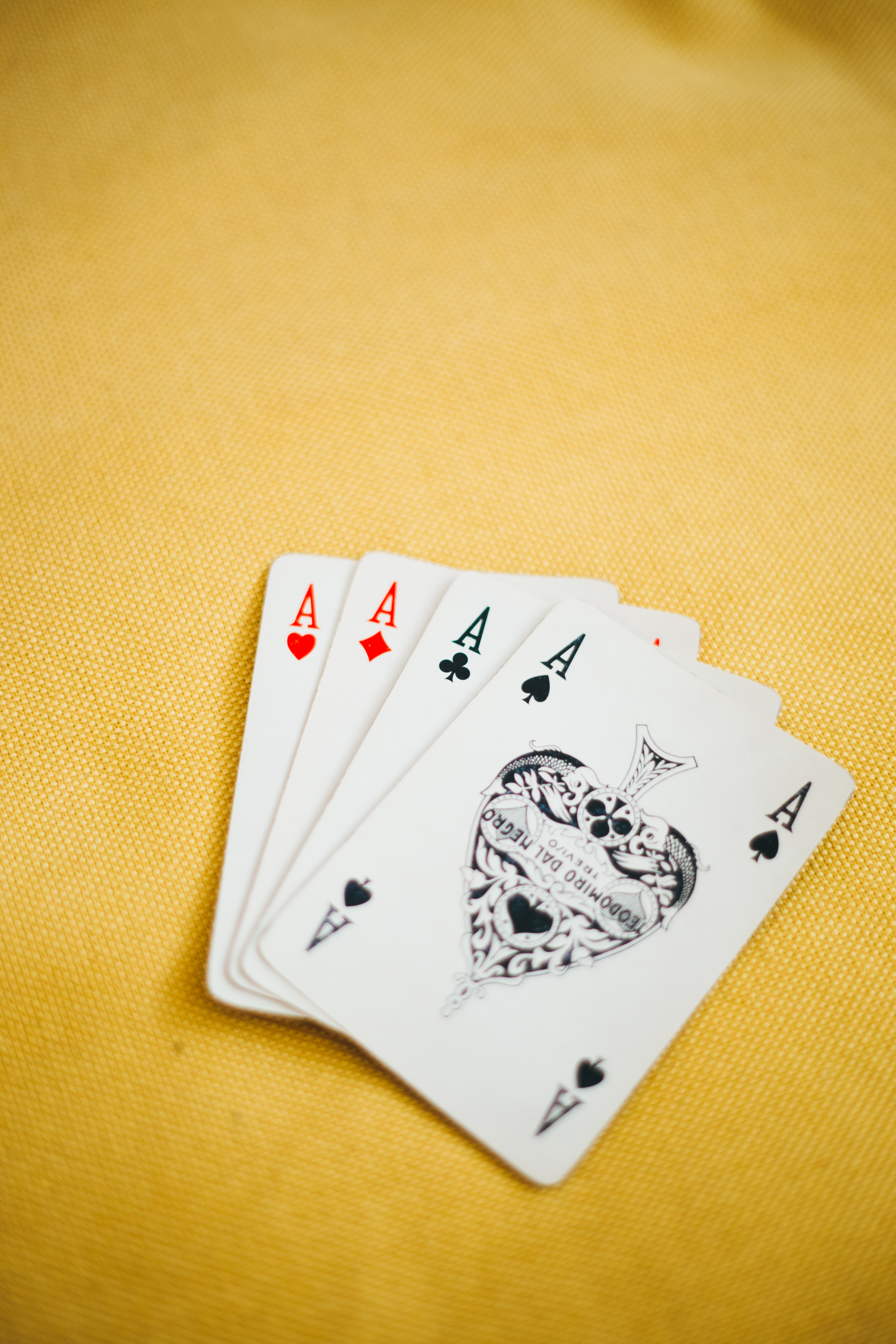 Ace Playing Cards on Brown Textile