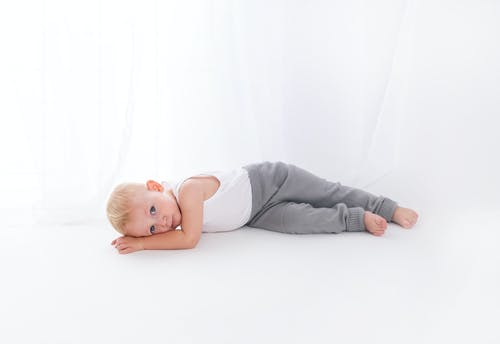 Photo of Baby Lying On Floor