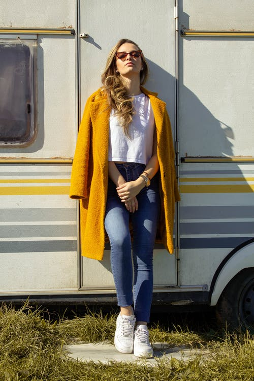 Woman Leaning Against Trailer