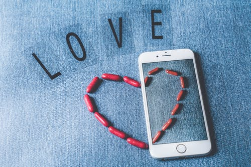Silver Iphone 6 Beside Love Freestanding Letters