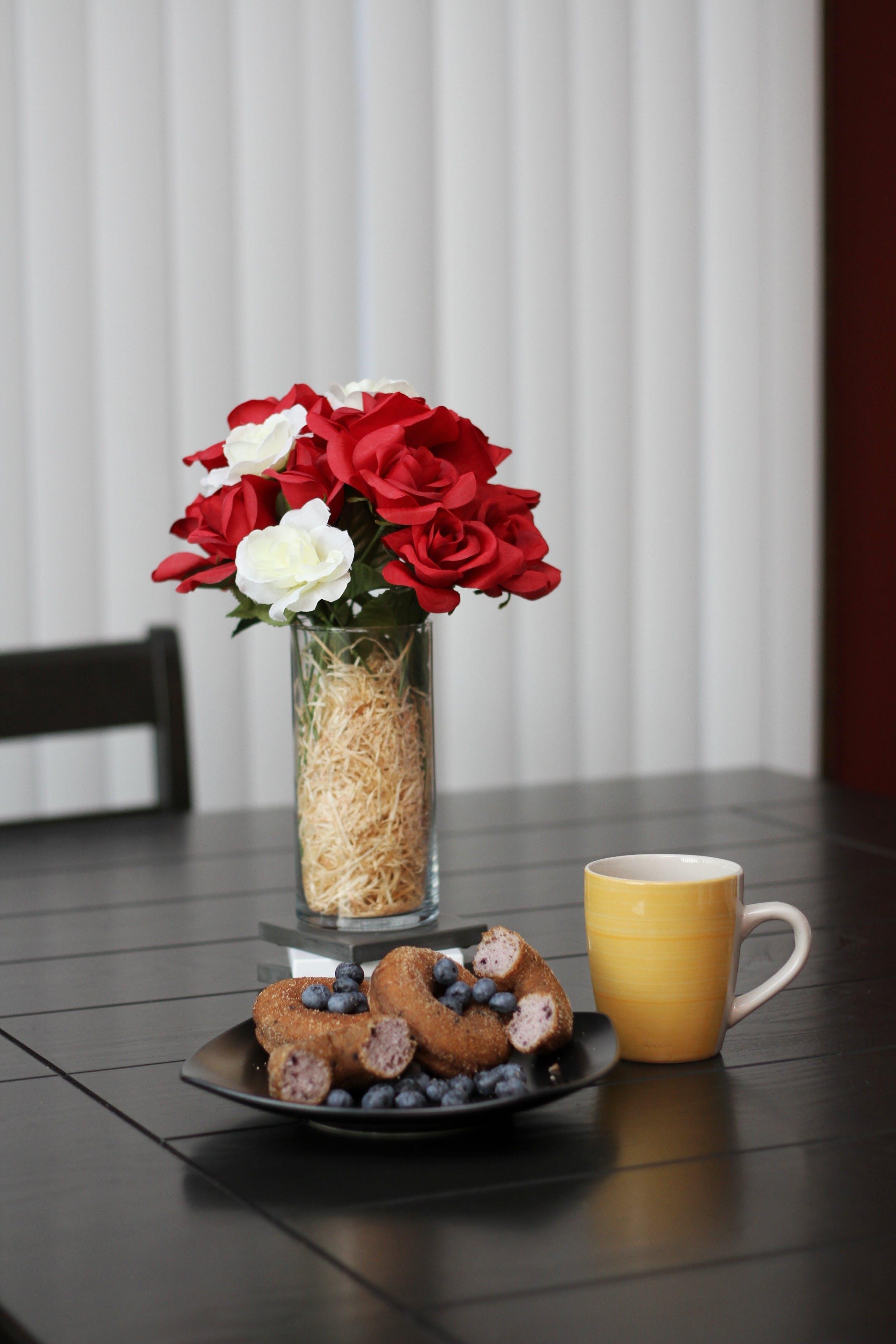 Photo of Roses in Glass Vase