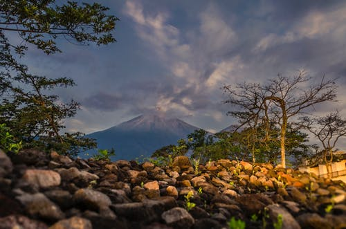 Free stock photo of blue sky, cloudy sky, fuego volcano, green