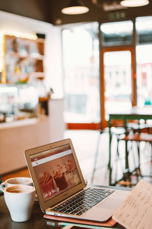 Photo of Laptop Beside White Mug