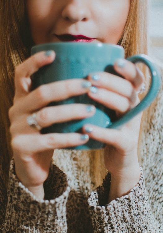 Woman Holding Blue Ceramic Mug