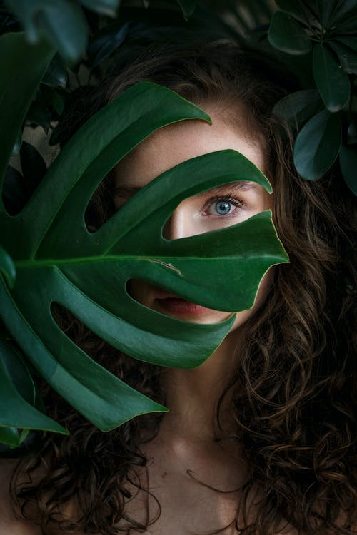 Photo Of Woman Covered With Leaves