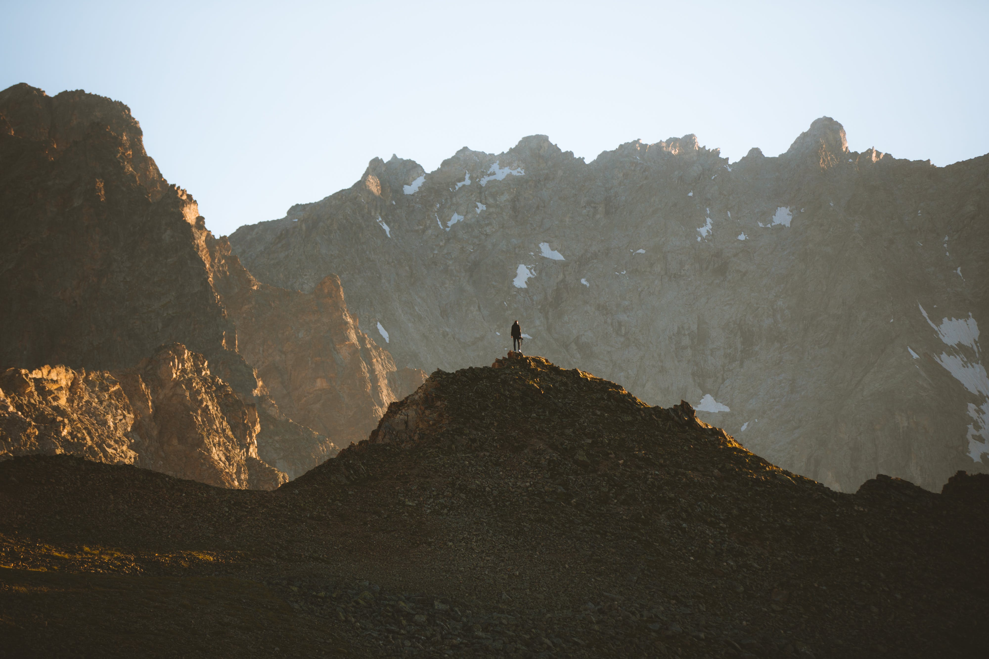 Person Standing Near Mountains