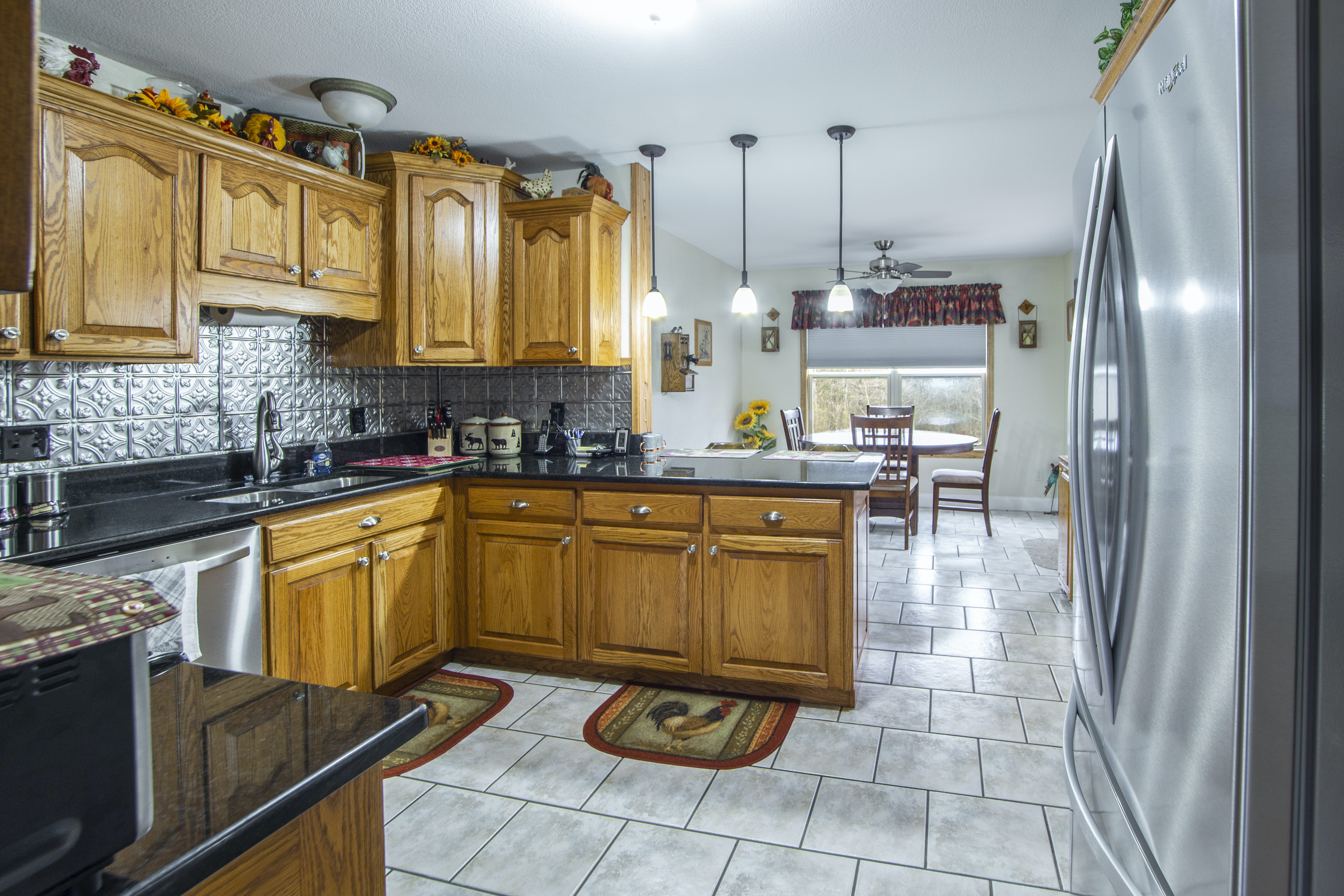 Photo of Wooden Cabinets and Refrigerator