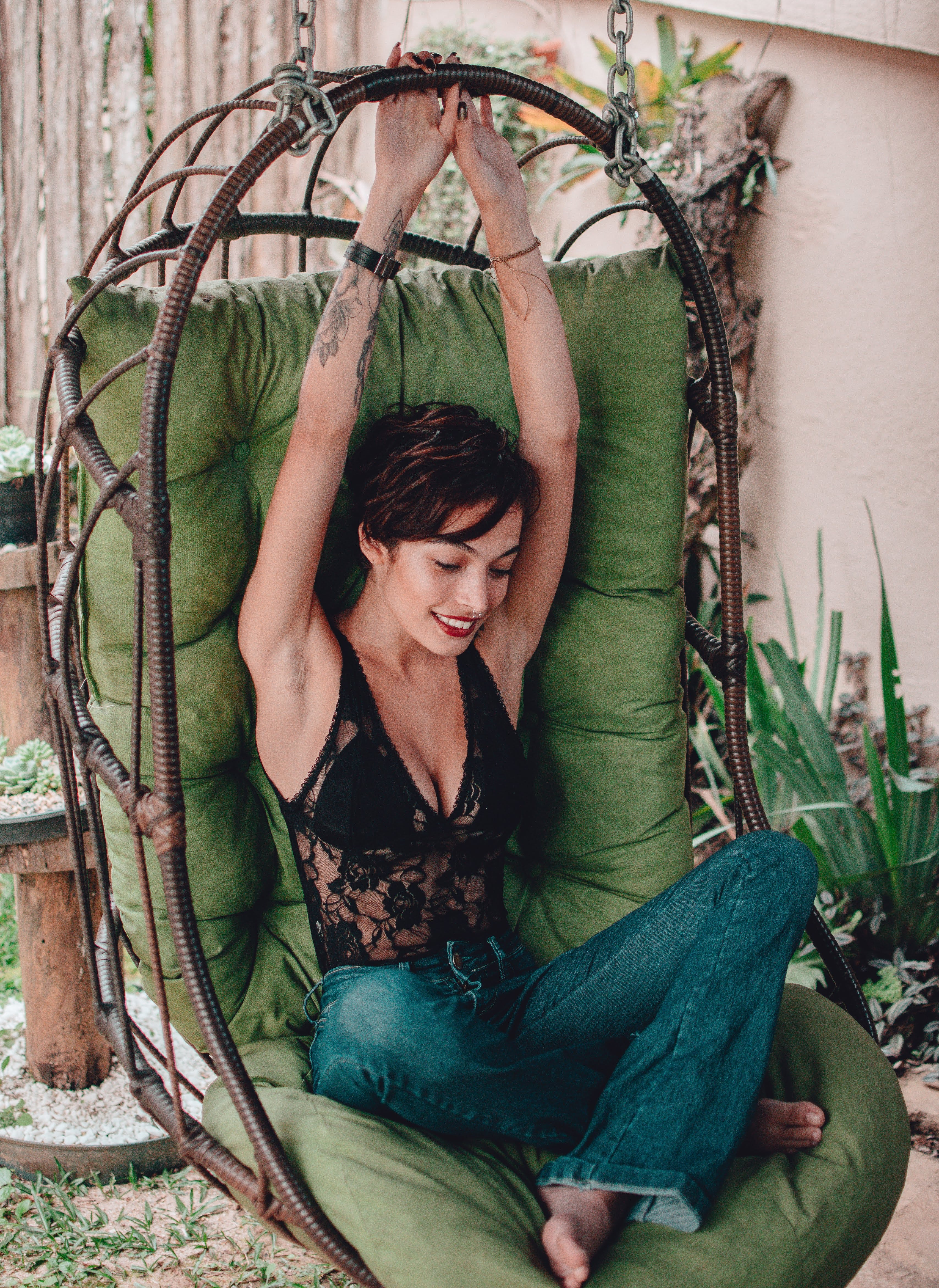 Photo of Woman Sitting On Hanging Chair