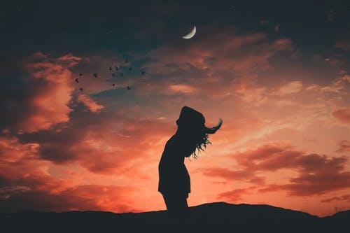 Silhouette Photo of Woman During Dawn