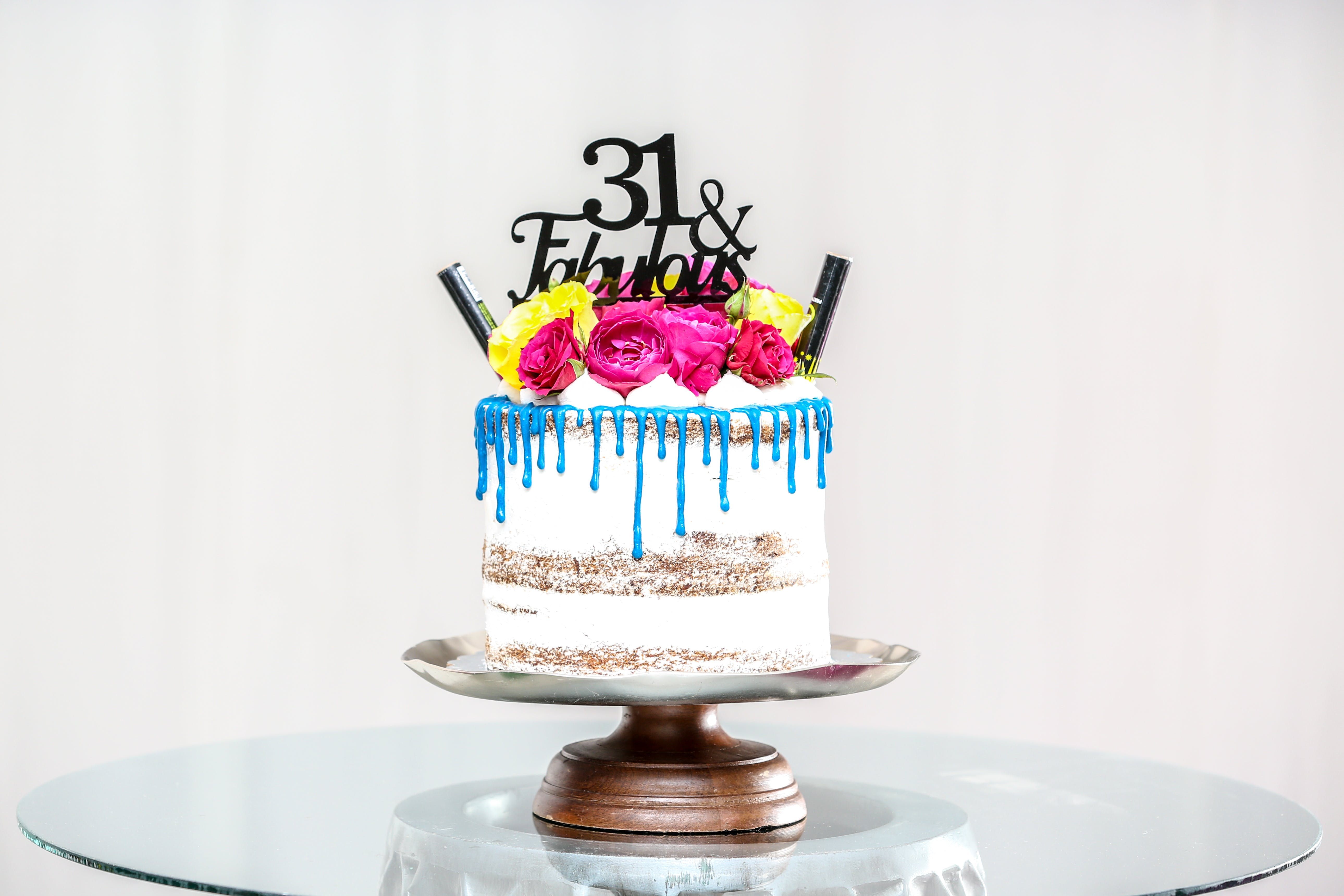 Baked Cake on Gray Cake Stand on Glass Table