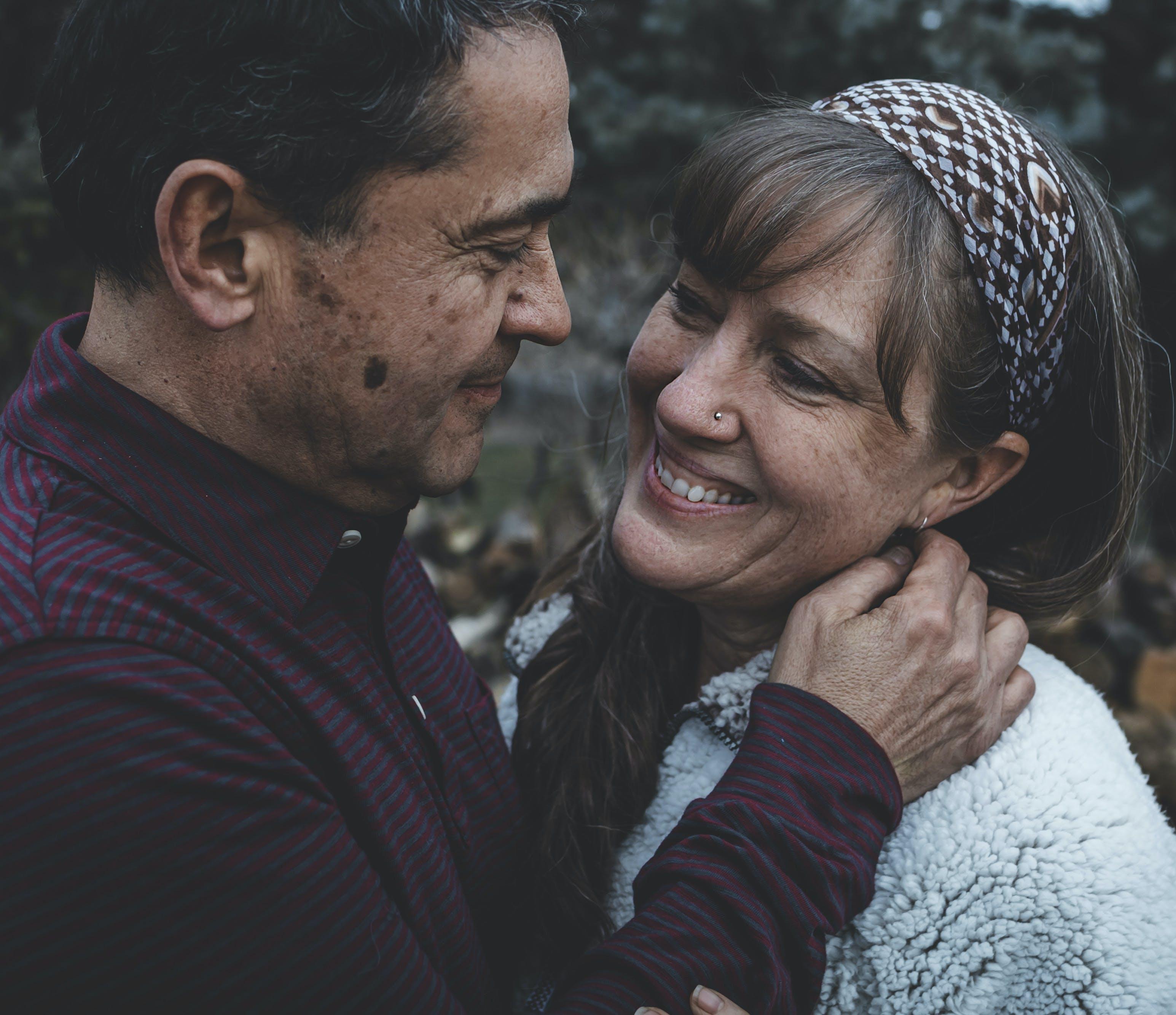 Man Looking at Woman's Face